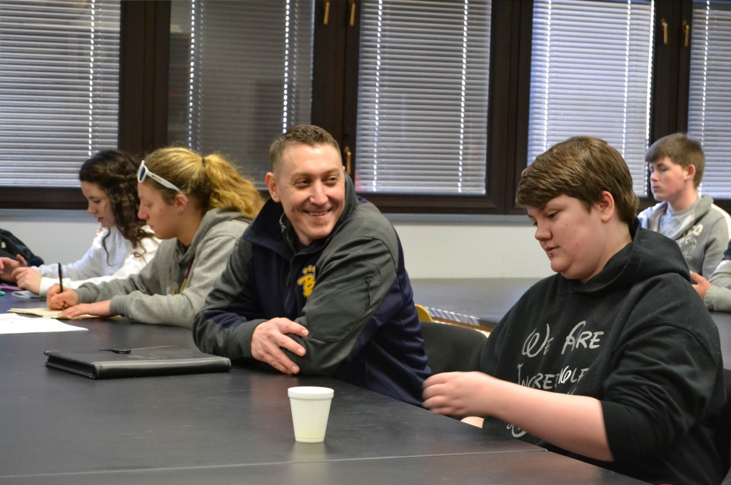Mr. Todd Barden of Bendle High School sits with his students for presentations on understanding the Flint water crisis.