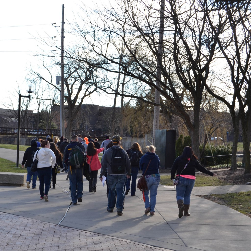 Bendle High School students cross campus to sessions focused on understanding the Flint water crisis.
