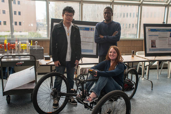 Members of the Human Powered Vehicle group pose with the UM-Flint Engineering Senior Design Project