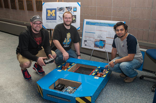 UM-Flint Engineering students pose with their tugger cart project.
