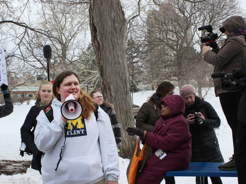 Tiffany Williams speaks to rally members and media during her #Justice4Flint demonstration.