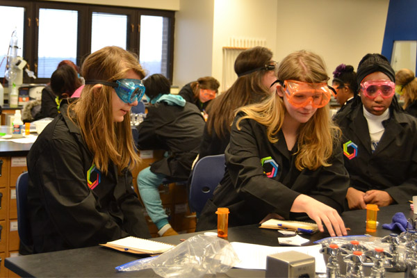 Curiosity Academy students conduct an experiment in the UM-Flint lab