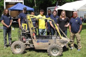 UM-Flint engineering students and faculty with their off-road racer