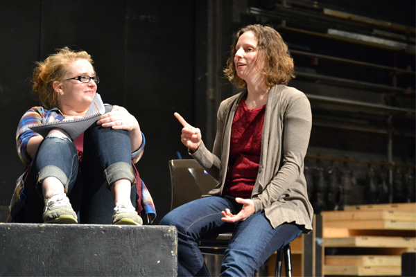 "Dean works with UM-Flint Theatre student Shelby Coleman on the set of ""Next to Normal."""