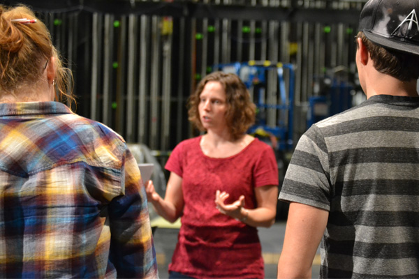 "UM-Flint Theatre's Stephanie Dean talks with cast members during a rehearsal of ""Next to Normal."""