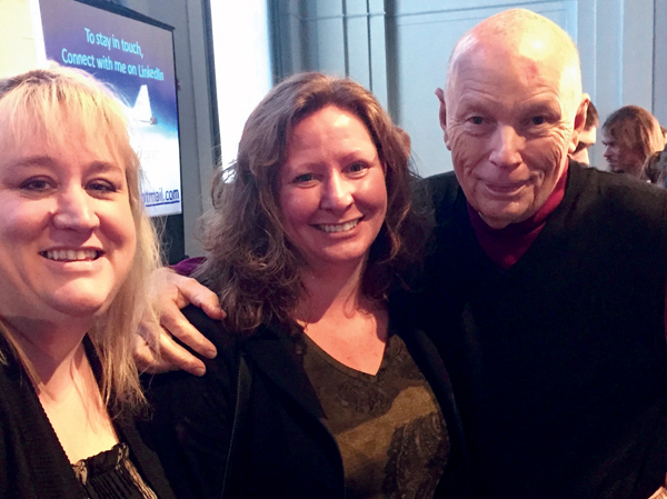 Katherine Eaton (left) and student Nancy Lareau pose with astronaut Story Musgrave