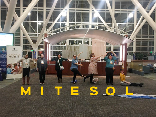 Feuerherm and her students spell out M-I-T-E-S-O-L while attending the 2017 MI-TESOL Conference.