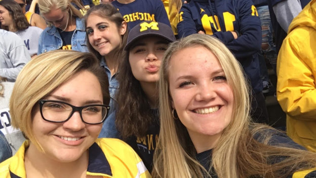 April Bartle and her friends in the crowd at Michigan Stadium