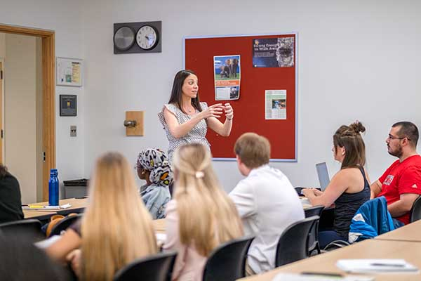 Dr. Kimberly Bender speaking in front of the class