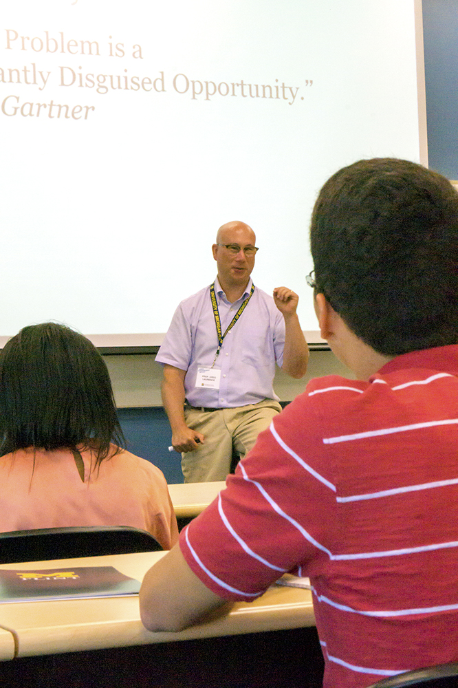 Professor Greg Laurence teaches summer camp students about the basics of Entrepreneurship.