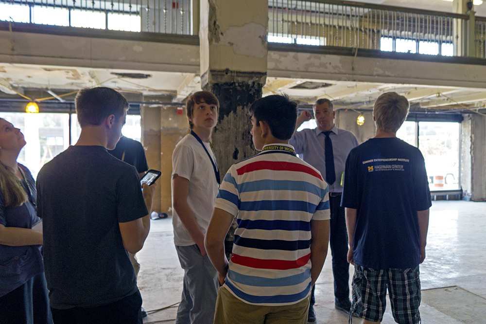 Summer camp students tour Skypoint Ventures. Bryce Moe, Managing Director of Skypoint Ventures, shows students a portion of the Dryden building that is under renovations.