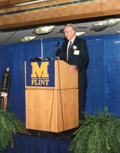 Dr. Kenneth West, professor in UM-Flint History Department, speaks at library dedication ceremony, October 1994
