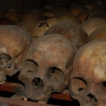 Skulls of victims from the Rwandan Genocide found at the Nyamata Memorial.   By The Dilly Lama and used under Creative Commons license.