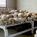 "Original caption states: ""Deep gashes delivered by the killers are visible in the skulls that fill one room at the Murambi School."" Aftermath of Rwandan Genocide."