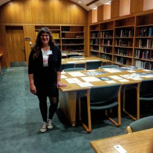 Our student worker is ready to answer questions about the Center's collections.