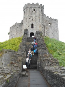 Students on stairs in a castle in Wales